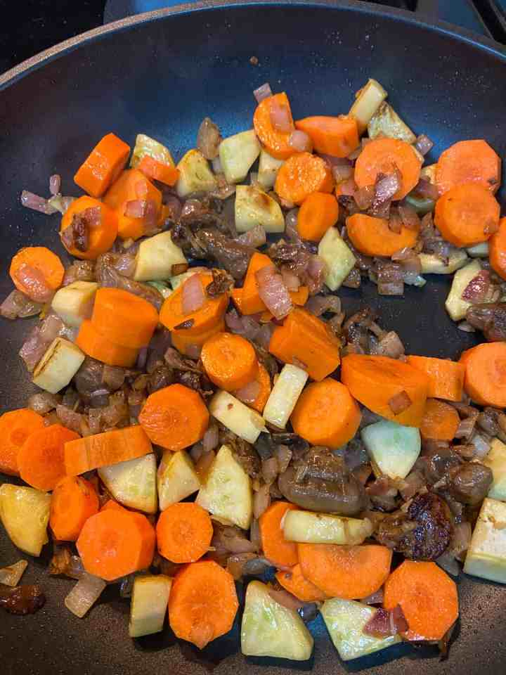 photo of vegetables frying in the pan.