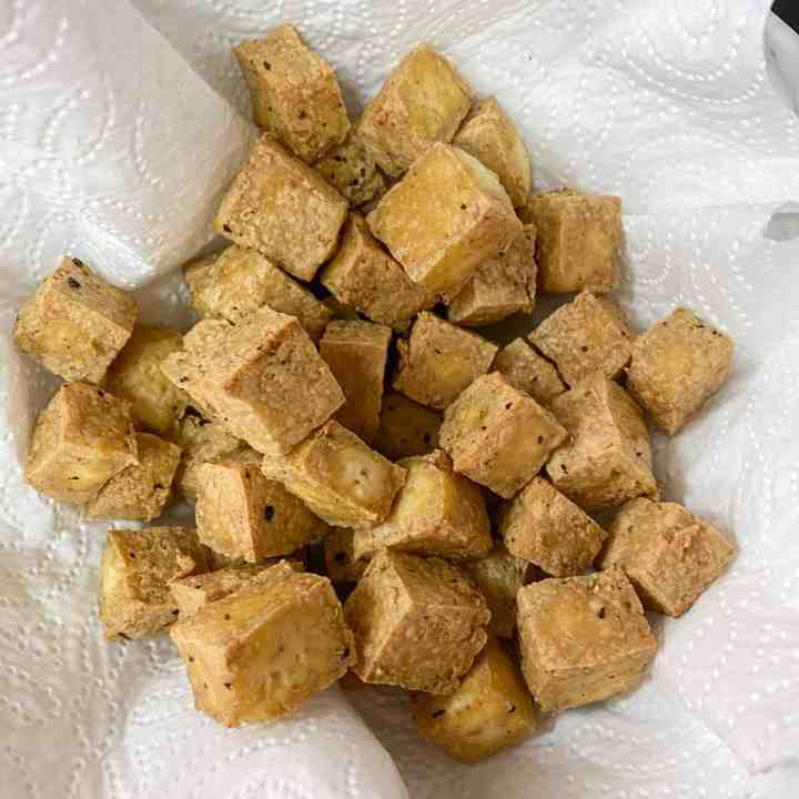 Photo of cooked tofu cubes on a kitchen towel.