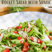 pinterest graphic showing Middle Eastern Rocket Salad with Sumac in a pretty decorated blue and white bowl.