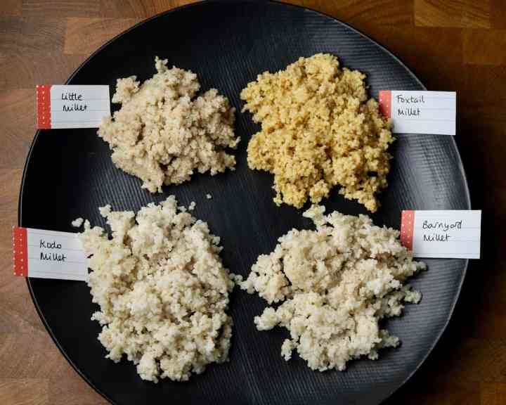 photo of a black plate showing labelled piles of cooked Kodo, barnyard, foxtail and little millet.