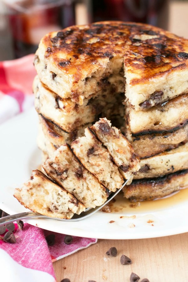 Stack of chocolate chip pancakes with a bite taken from them