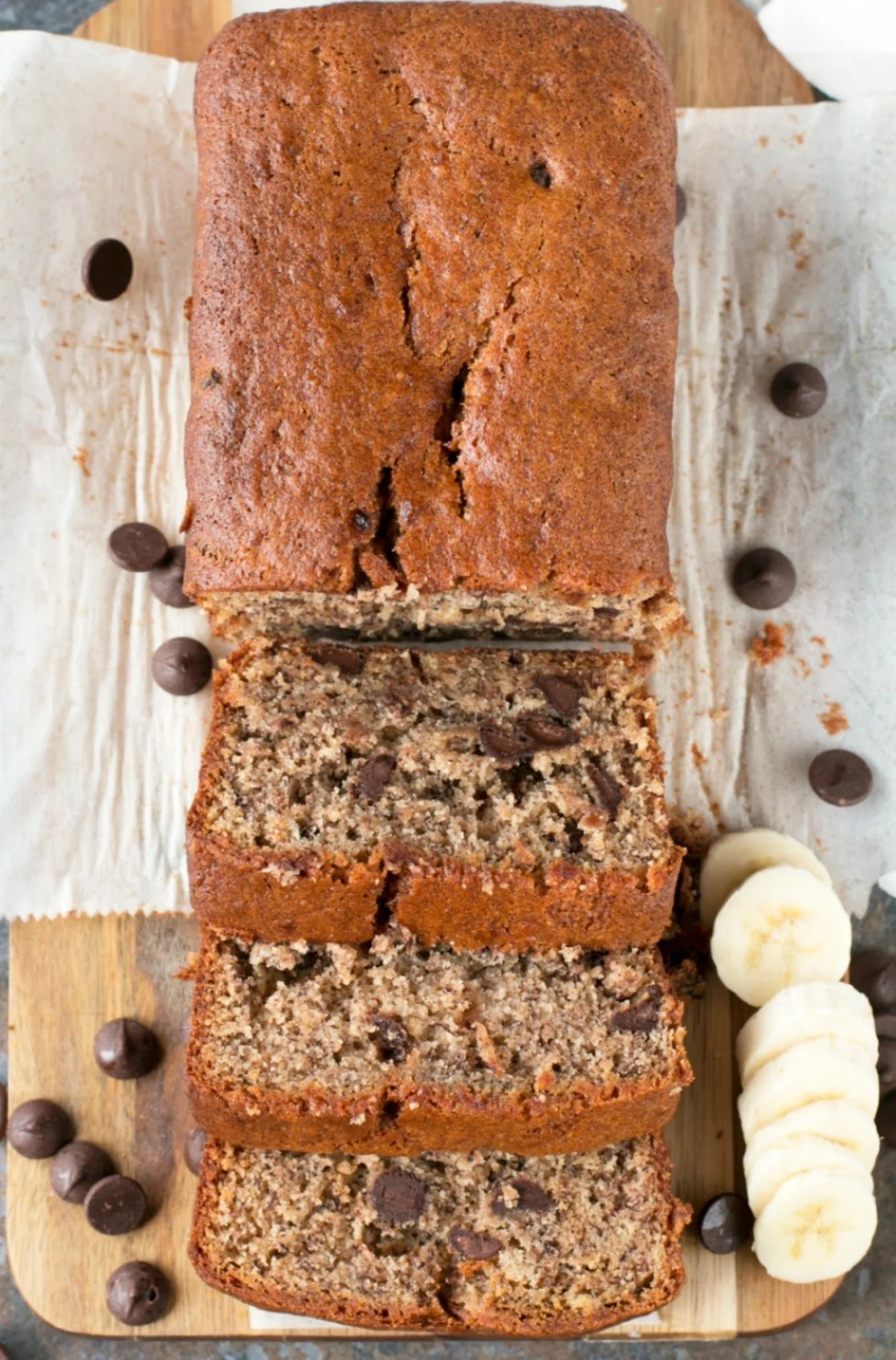 Overhead picture of chocolate chip banana bread sliced on cutting board