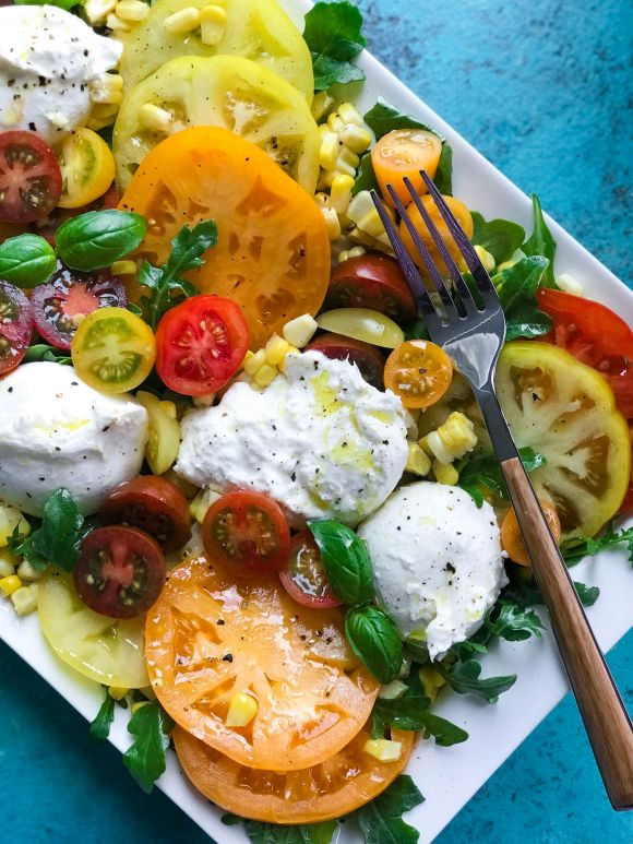 Tomato and Burrata Salad on a plate