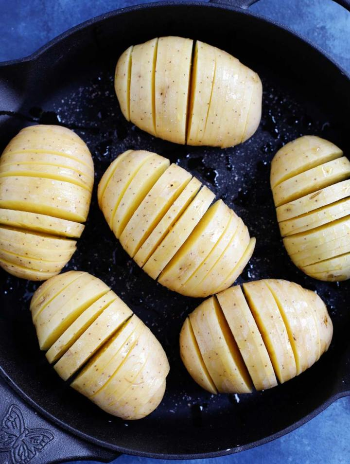 hassleback potatoes in a skillet