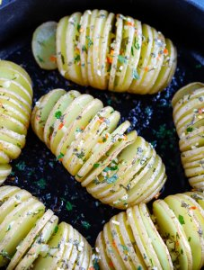 Baked hassleback potatoes with cilantro