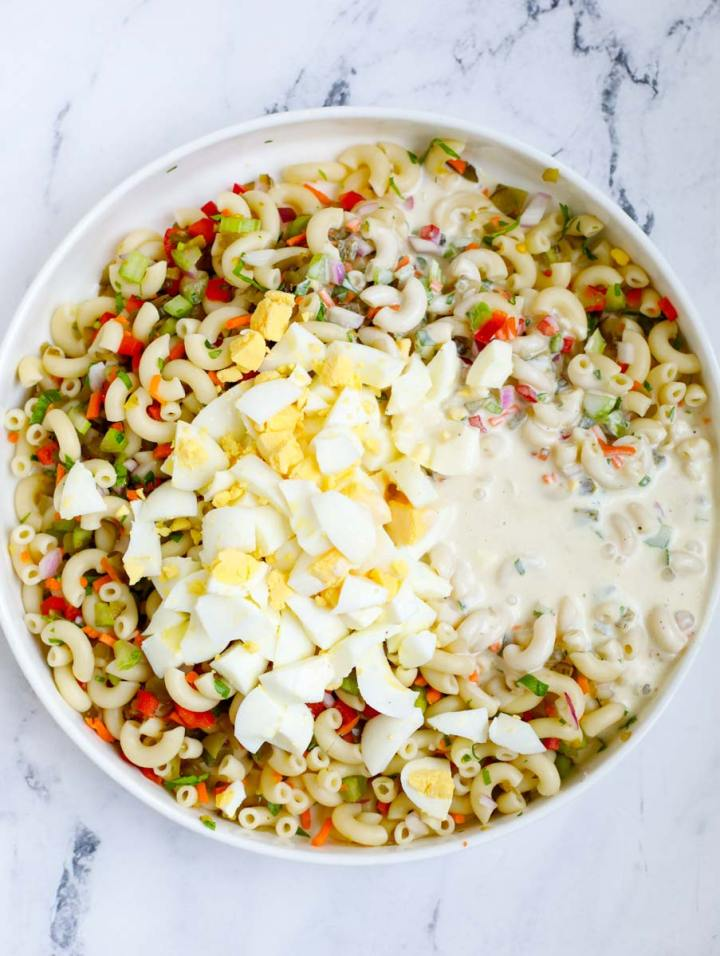 Ingredients for Easy Macaroni Salad tossed together
