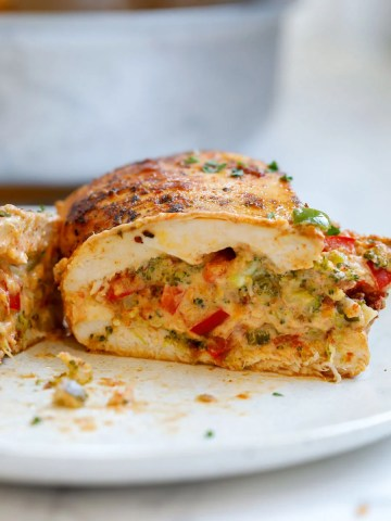 piece of chicken cut in the middle to show stuffing inside