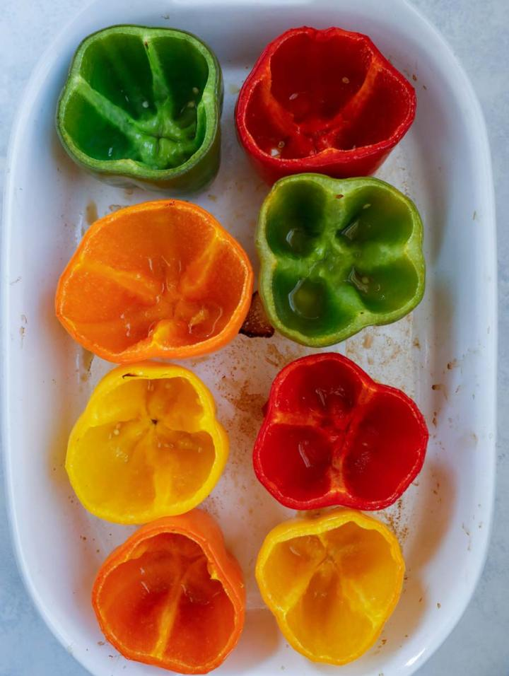hollowed peppers in a baking dish.