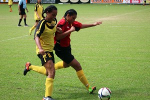 Aitutaki and Ellerslie players contest for the ball