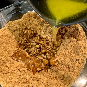 Mixing butter and cookie crumbs