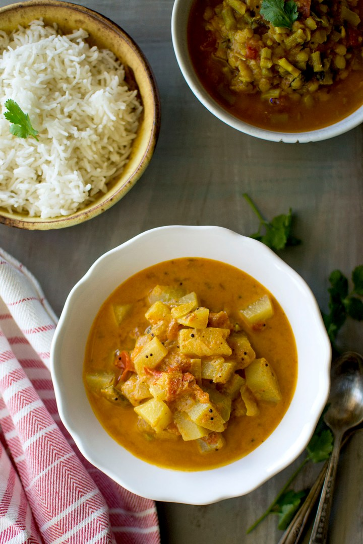 White bowl with Chayote Curry with bowl of rice