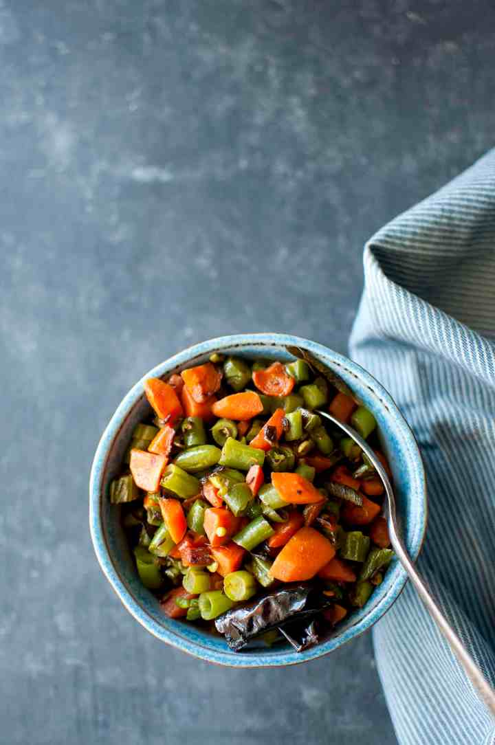 Blue bowl with carrot and green bean stir fry