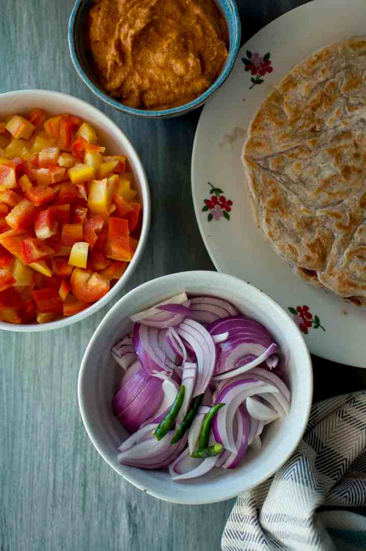 Ingredients needed - salna, parotta, sliced onions, green chilies, peppers