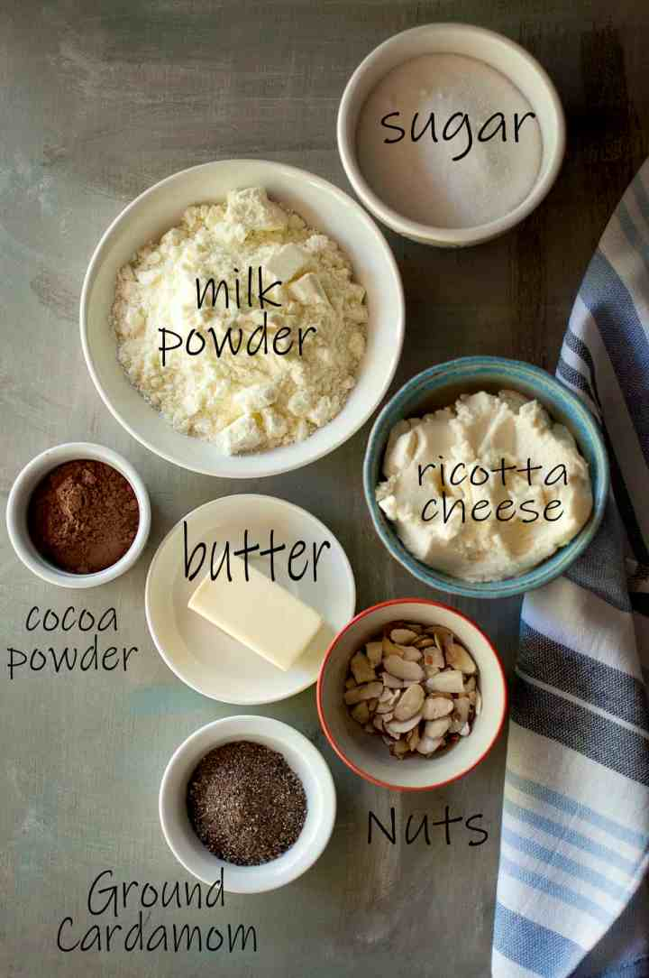 Ingredients needed - sugar, milk powder, ricotta cheese, butter, cocoa powder, unsalted butter, almonds, ground cardamom