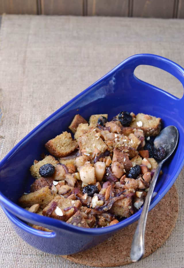 Blue casserole dish with vegetarian fruit & nut stuffing for Thanksgiving