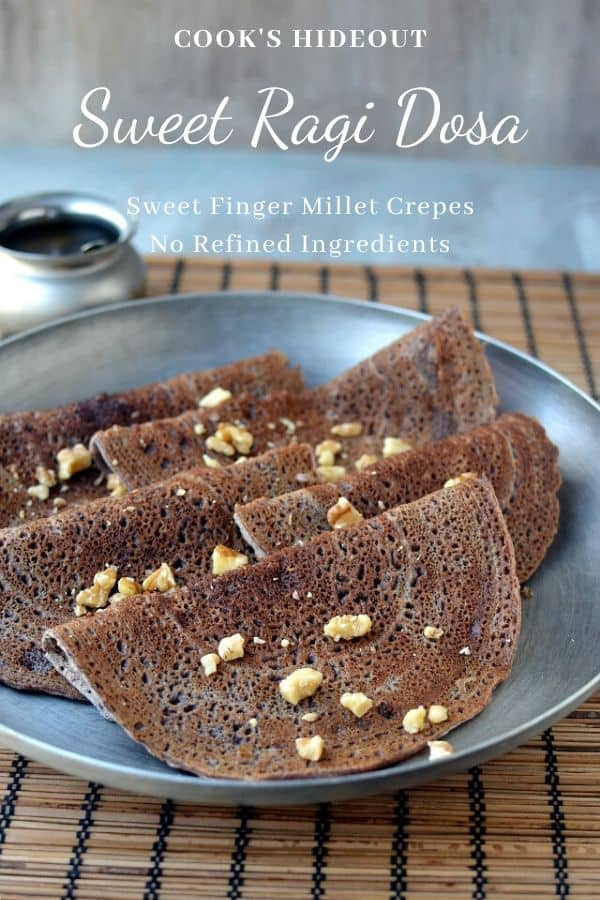 Tray with Sweet Ragi Dosa topped with chopped walnuts