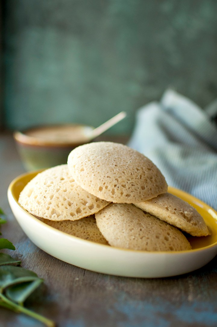 White plate with stack of idli