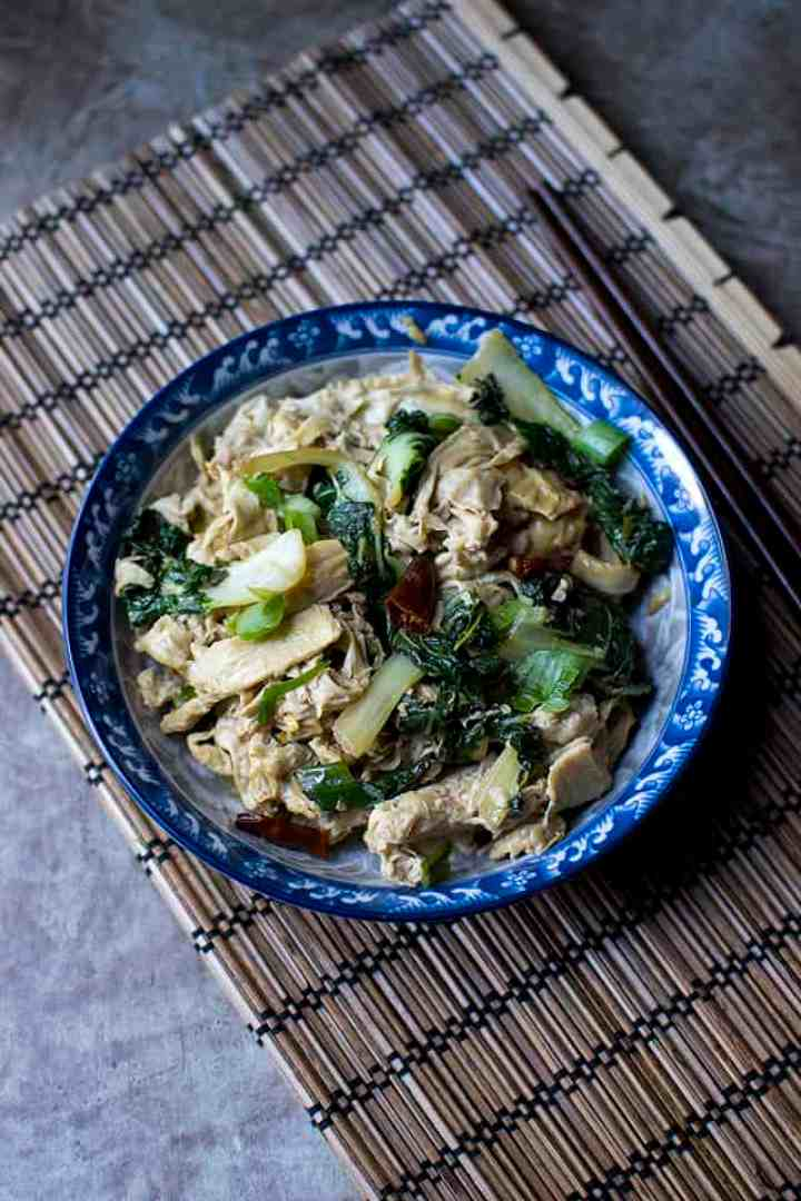 Blue bowl with Chinese bean curd skin bok choy stir fry