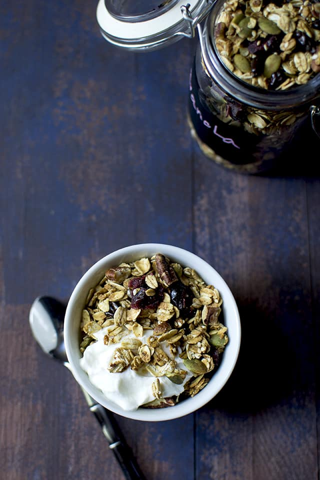 Top view photo of yogurt with granola breakfast