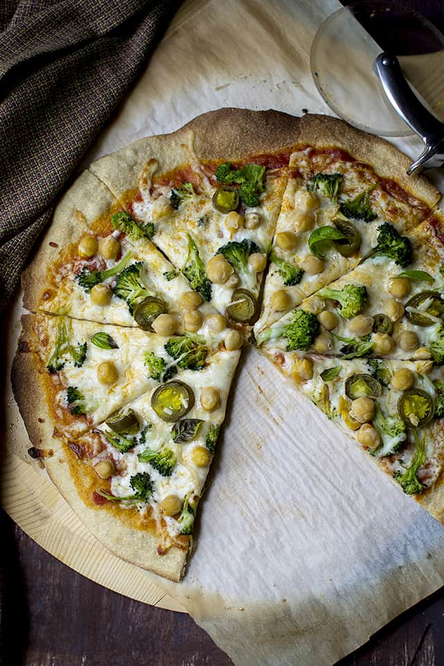 Vegetarian thin pizza crust with lots of veggies and cheese