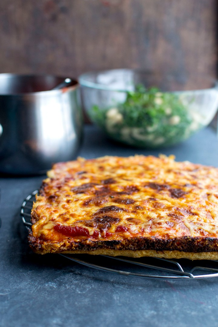 Steel rack with Detroit style cheese pizza