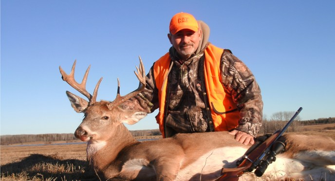 hunter with whitetail - image