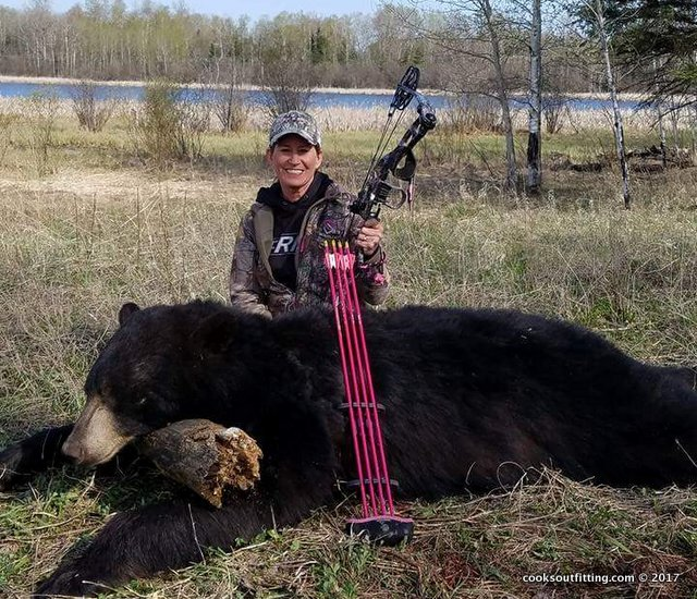 big black bear female hunter - image