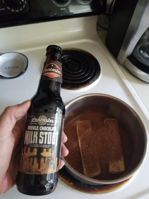 Double chocolate milk stout bottle with butter and cocoa powder