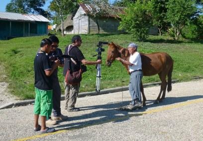 The documentary crew interviews Pedro Pop