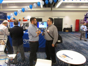 Joel standing with Tyler from Optilec at CSUN 2016