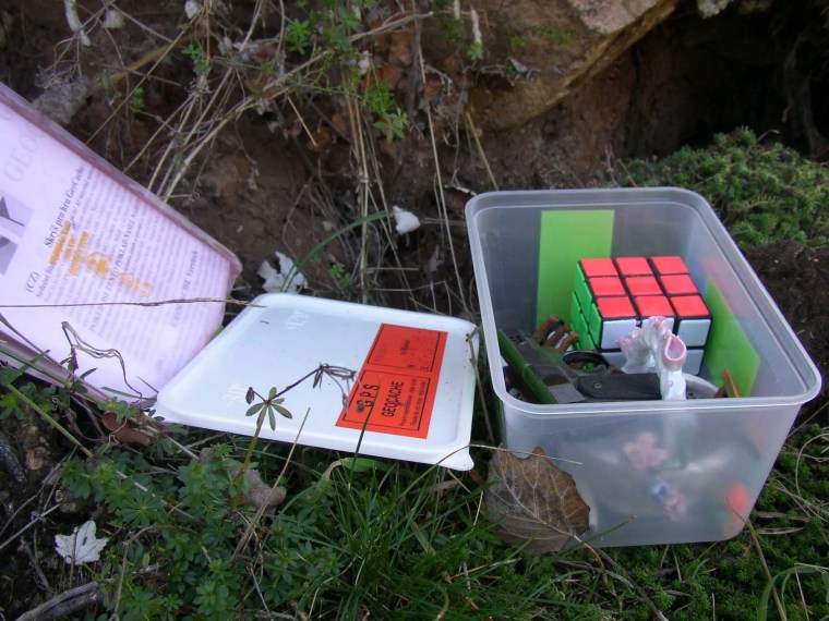 Most Geocaches include a log book and other items. If you take an item, you must leave one of your own.