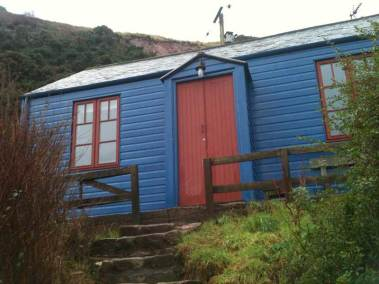 Blue Cabin by the Sea Exterior