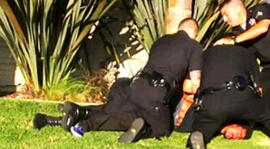 Los Angeles Police Beat Man for Riding Skateboard on Wrong Side of Street