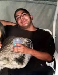Andrew Arevalo was also shot and seriously injured by a guard's shotgun, but survived.