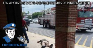 Fed Up Citizens Taunt and Take Pictures of Injured Officer