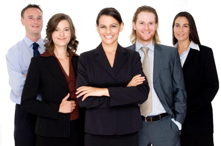 A group of five young business professionals looking happy and confident on white background