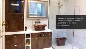 Copper sink and bucket matching bathtub design.