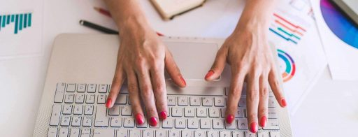 Close up of busy female hand typing on keyboard (copy-paste-emails)