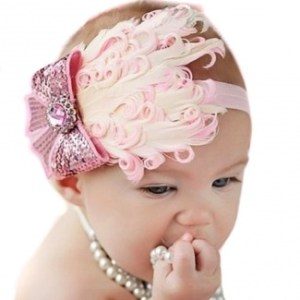 The fistful of pearls in the mouth are a nice touch, because everyone knows that babies are really into the 1920s flapper look of OMG, SHE'S CHOKING!