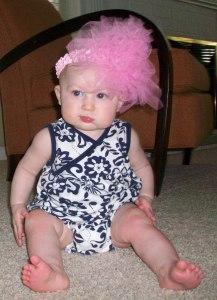 Her headband says she's fun and flirty. But her eyes say she's plotting her revenge.