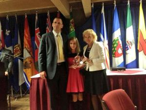 Sean and Abbie Webb accept the NSS Exemplary Service Award on behalf of the Webb Family