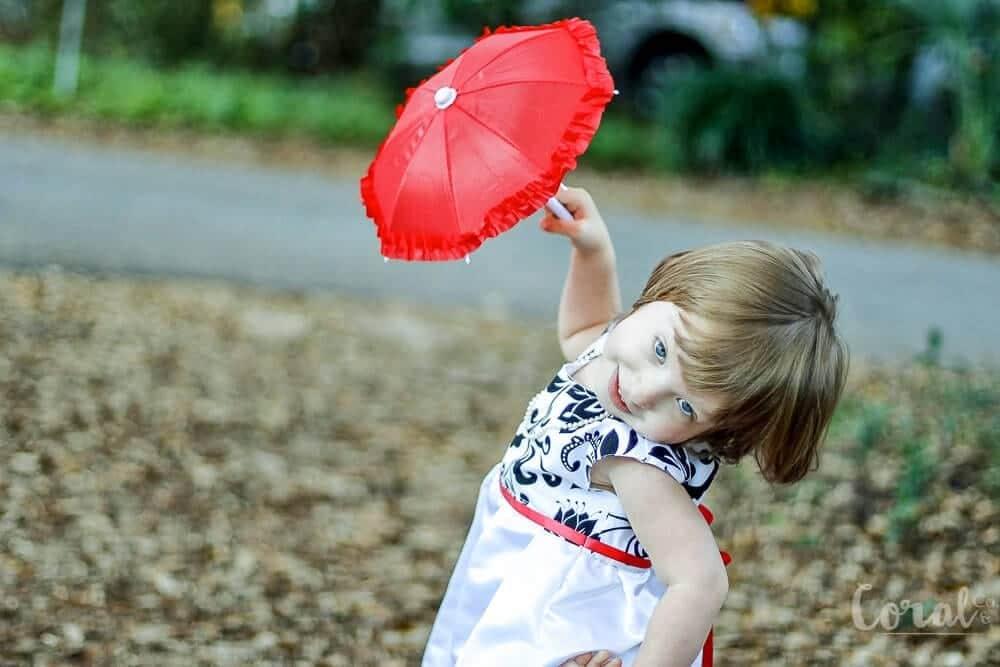 red-umbrella-little-girl-twirling