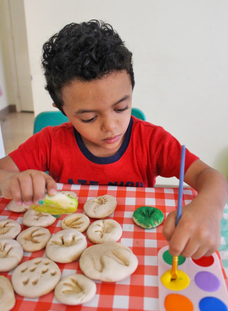 Kids Activities at Home painting dinosaur fossils