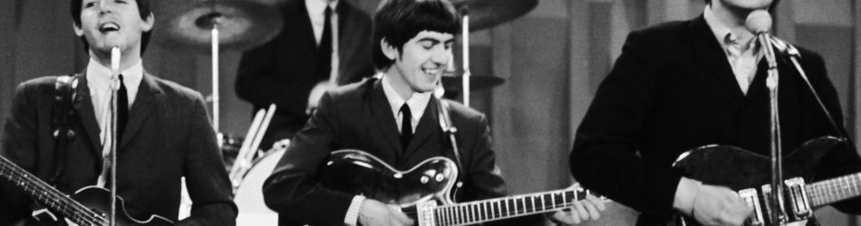 """The Beatles are shown during their performance on the """"Ed Sullivan Show,"""" Feb. 10, 1964, their first appearance on American television. From left to right:  bassist Paul McCartney; drummer Ringo Starr; guitarist George Harrison; guitarist John Lennon. (AP Photo/Dan Grossi)"""