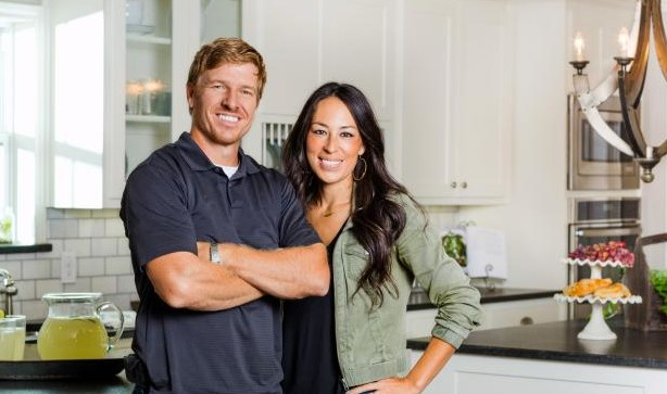 chip and joanna gaines standing in their kitchen