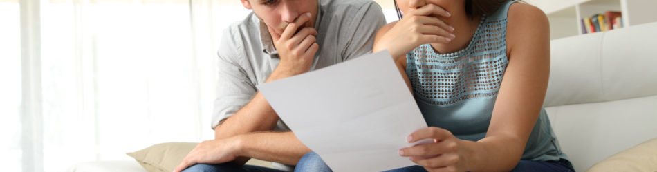 Couple looking over bills