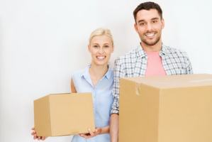 Couple with Moving Boxes ready for Belleville Movers