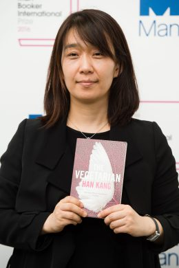 Korean author Han Kang poses for a photograph with her book The Vegetarian at a photocall in London on May 15, 2016, ahead of tomorrow's announcement of the winner of the 2016 Man Booker International Prize. / AFP / Leon NEAL        (Photo credit should read LEON NEAL/AFP/Getty Images)