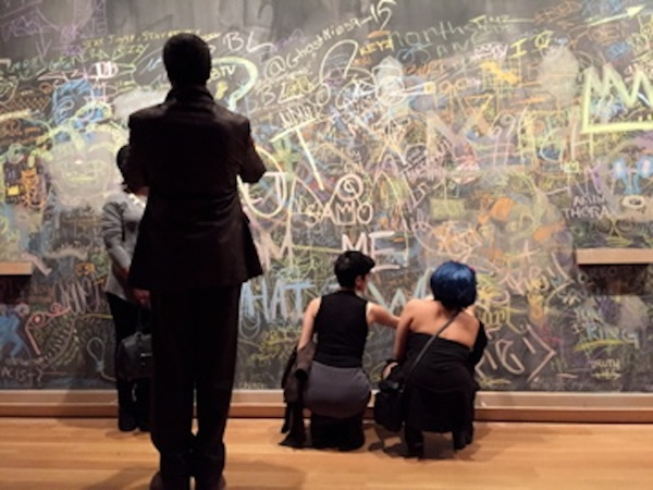 Audience members take pictures and leave chalk messages on the wall after the Basquiat show at the AGO, photo by Cherryl Bird
