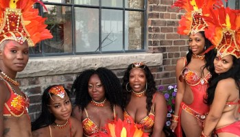 Friends gather after the Toronto Caribbean Carnival Parade, also known as Caribana, photo by Cherryl Bird